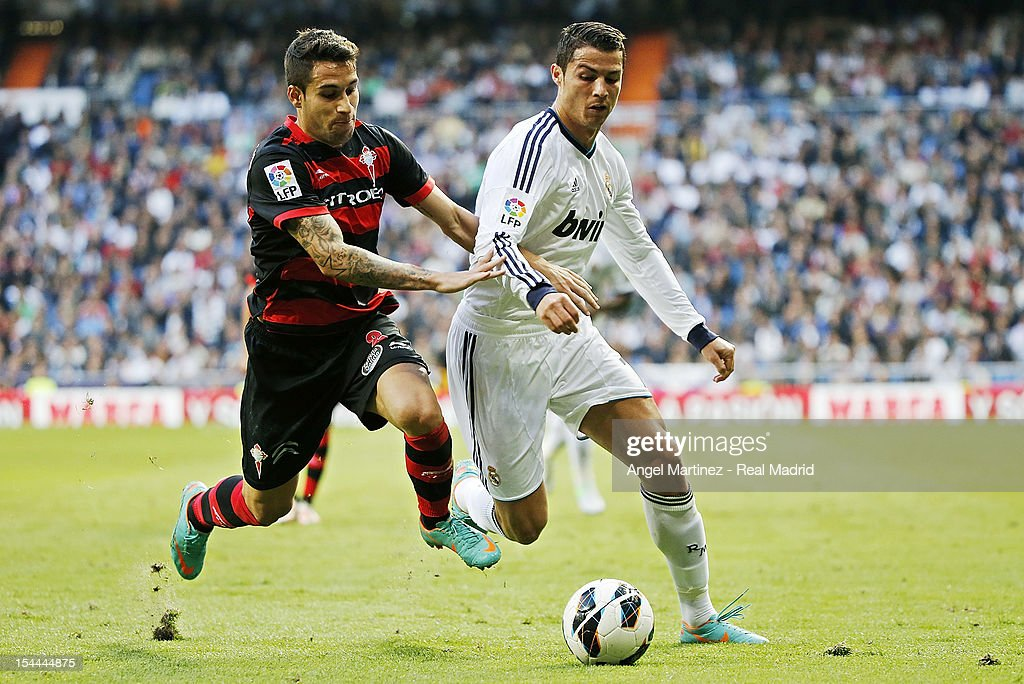 <a gi-track='captionPersonalityLinkClicked' href=/galleries/search?phrase=Cristiano+Ronaldo+-+Soccer+Player&family=editorial&specificpeople=162689 ng-click='$event.stopPropagation()'>Cristiano Ronaldo</a> of Real Madrid competes for the ball with <a gi-track='captionPersonalityLinkClicked' href=/galleries/search?phrase=Hugo+Mallo&family=editorial&specificpeople=8007772 ng-click='$event.stopPropagation()'>Hugo Mallo</a> of Celta de Vigo during the La Liga match between Real Madrid and Celta de Vigo at Bernabeu on October 20, 2012 in Madrid, Spain.