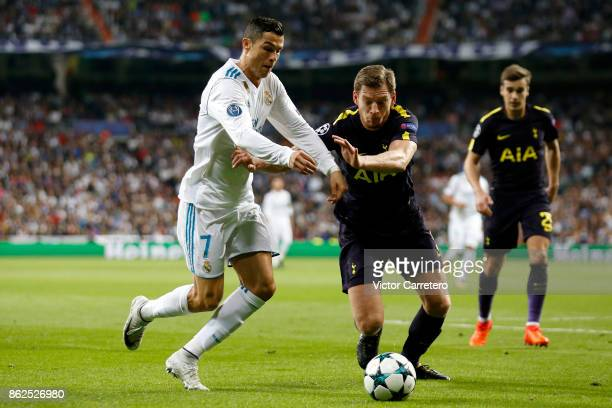 Cristiano Ronaldo of Real Madrid competes for the ball with Jan Vertonghen of Tottenham Hotspur during the UEFA Champions League group H match...