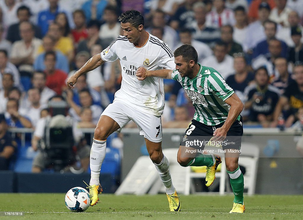 <a gi-track='captionPersonalityLinkClicked' href=/galleries/search?phrase=Cristiano+Ronaldo+-+Soccer+Player&family=editorial&specificpeople=162689 ng-click='$event.stopPropagation()'>Cristiano Ronaldo</a> of Real Madrid competes for the ball with Javier Chica of Betis during the La Liga match between Real Madrid CF and Real Betis at Estadio Santiago Bernabeu on August 18, 2013 in Madrid, Spain.