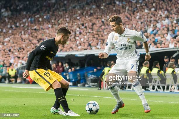 Cristiano Ronaldo of Real Madrid competes for the ball with Lucas Hernandez of Atletico de Madrid in action during their 201617 UEFA Champions League...