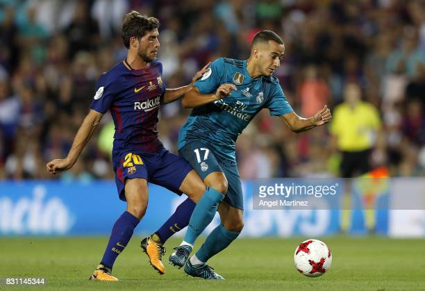 Cristiano Ronaldo of Real Madrid competes for the ball with Sergi Roberto of FC Barcelona during the Supercopa de Espana Final first leg match...