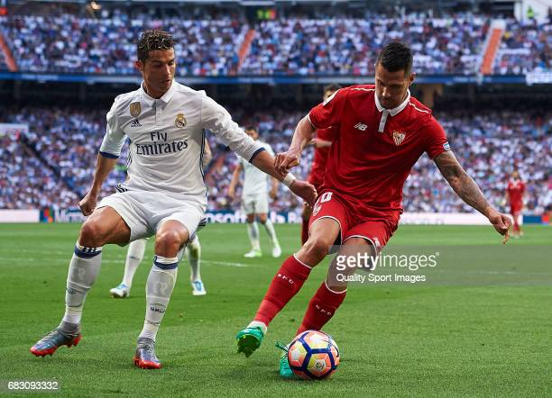 Cristiano Ronaldo of Real Madrid competes for the ball with Vitolo of Sevilla during the La Liga match between Real Madrid CF and Sevilla CF at...
