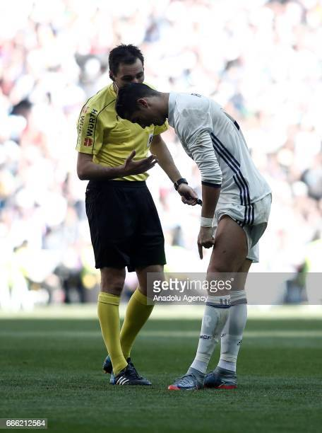 Cristiano Ronaldo of Real Madrid complains to referee during the La Liga football match between Real Madrid and Atletico Madrid at Santiago Bernabeu...