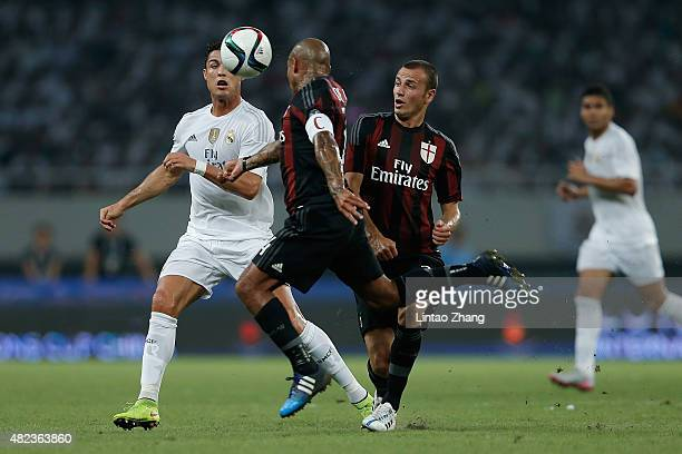 Cristiano Ronaldo of Real Madrid contests the ball against Nigel de Jong of AC Milan during the International Champions Cup match between Real Madrid...