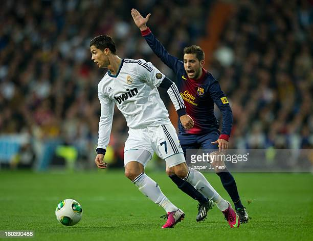 Cristiano Ronaldo of Real Madrid controls the ball besides Jordi Alba of Barcelona appealing for a hands ball during the Copa del Rey semi final...