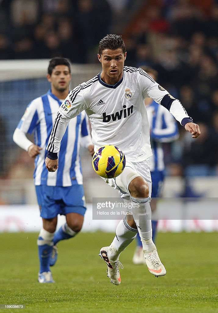 <a gi-track='captionPersonalityLinkClicked' href=/galleries/search?phrase=Cristiano+Ronaldo&family=editorial&specificpeople=162689 ng-click='$event.stopPropagation()'>Cristiano Ronaldo</a> (R) of Real Madrid controls the ball during the La Liga match between Real Madrid and Real Sociedad at Estadio Santiago Bernabeu on January 6, 2013 in Madrid, Spain.