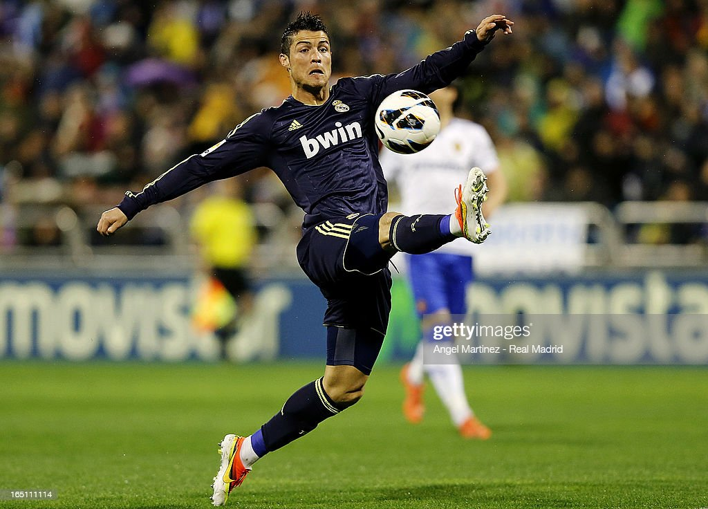 <a gi-track='captionPersonalityLinkClicked' href=/galleries/search?phrase=Cristiano+Ronaldo+-+Soccer+Player&family=editorial&specificpeople=162689 ng-click='$event.stopPropagation()'>Cristiano Ronaldo</a> of Real Madrid controls the ball during the La Liga match between Real Zaragoza and Real Madrid at La Romareda on March 30, 2013 in Zaragoza, Spain.