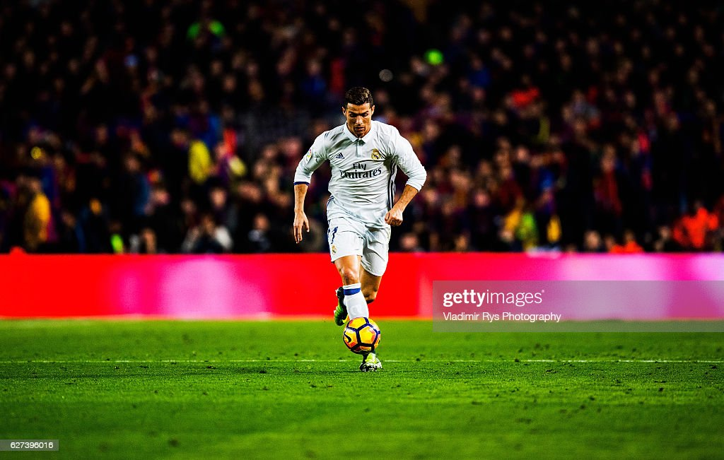 Cristiano Ronaldo of Real Madrid controls the ball during the La Liga match between FC Barcelona and Real Madrid CF at Camp Nou stadium on December...