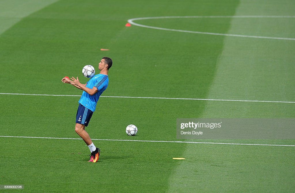 <a gi-track='captionPersonalityLinkClicked' href=/galleries/search?phrase=Cristiano+Ronaldo+-+Soccer+Player&family=editorial&specificpeople=162689 ng-click='$event.stopPropagation()'>Cristiano Ronaldo</a> of Real Madrid controls the ball during the team training session at the Real Madrid Open Media Day ahead of the UEFA Champions League Final against Club Atletico Madrid at Valdebebas training ground on May 24, 2016 in Madrid, Spain.