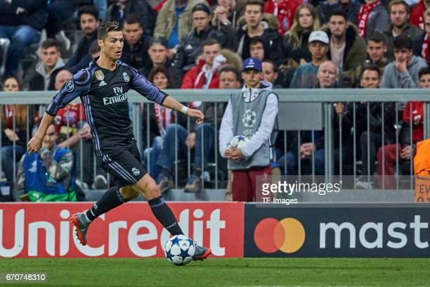 Cristiano Ronaldo of Real Madrid controls the ball during the UEFA Champions League Quarter Final first leg match between FC Bayern Muenchen and Real...
