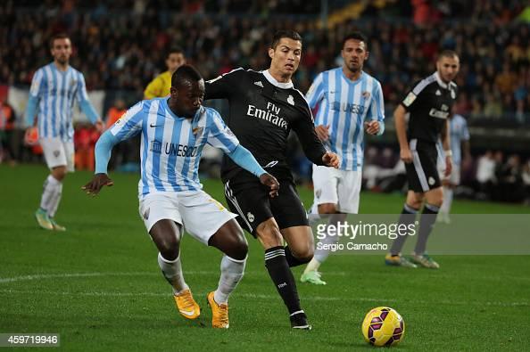 Cristiano Ronaldo of Real Madrid duels for the ball with Arthur Boka of Malaga CF during the La Liga match between Malaga CF and Real Madrid CF at La...