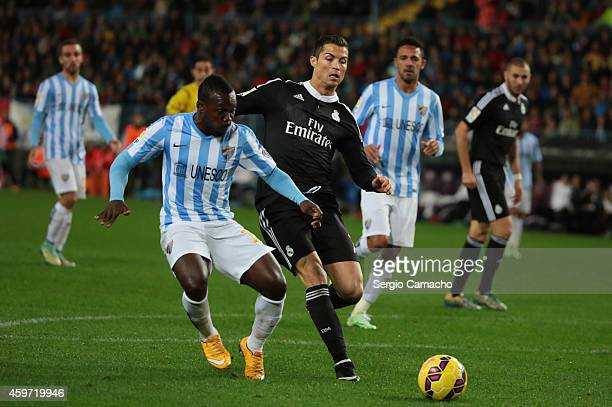 Cristiano Ronaldo of Real Madrid duels for the ball with Arthur Boka of Malaga CF during the La Liga match between Malaga CF and Real Madrid CF at La...