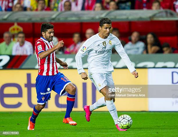 Cristiano Ronaldo of Real Madrid duels for the ball with Carlos Carmona of Real Sporting de Gijon during the La Liga match between Sporting Gijon and...
