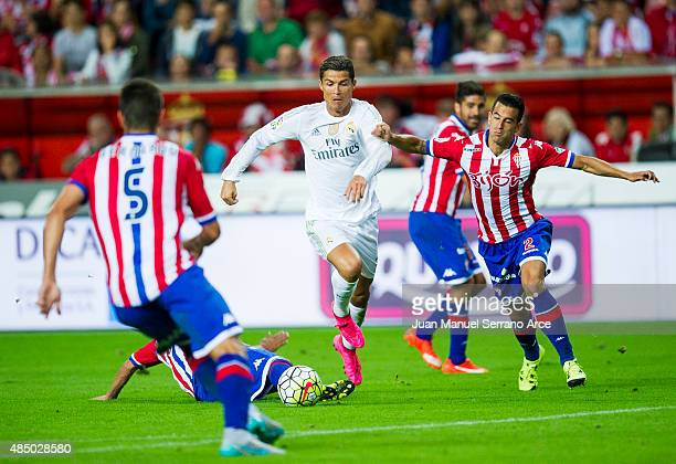 Cristiano Ronaldo of Real Madrid duels for the ball with Luis Hernandez of Real Sporting de Gijon during the La Liga match between Sporting Gijon and...