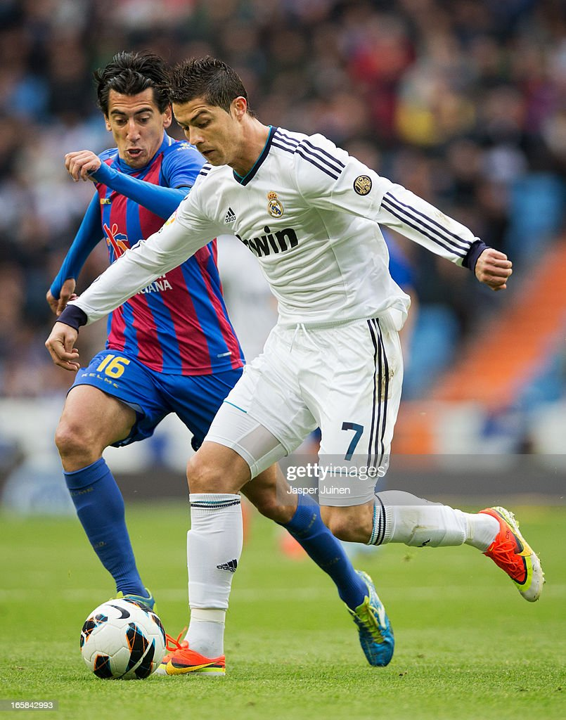 Cristiano Ronaldo (R) of Real Madrid duels for the ball with Pedro Rios of Levante during the la Liga match between Real Madrid CF and Levante UD at Estadio Santiago Bernabeu on April 6, 2013 in Madrid, Spain.
