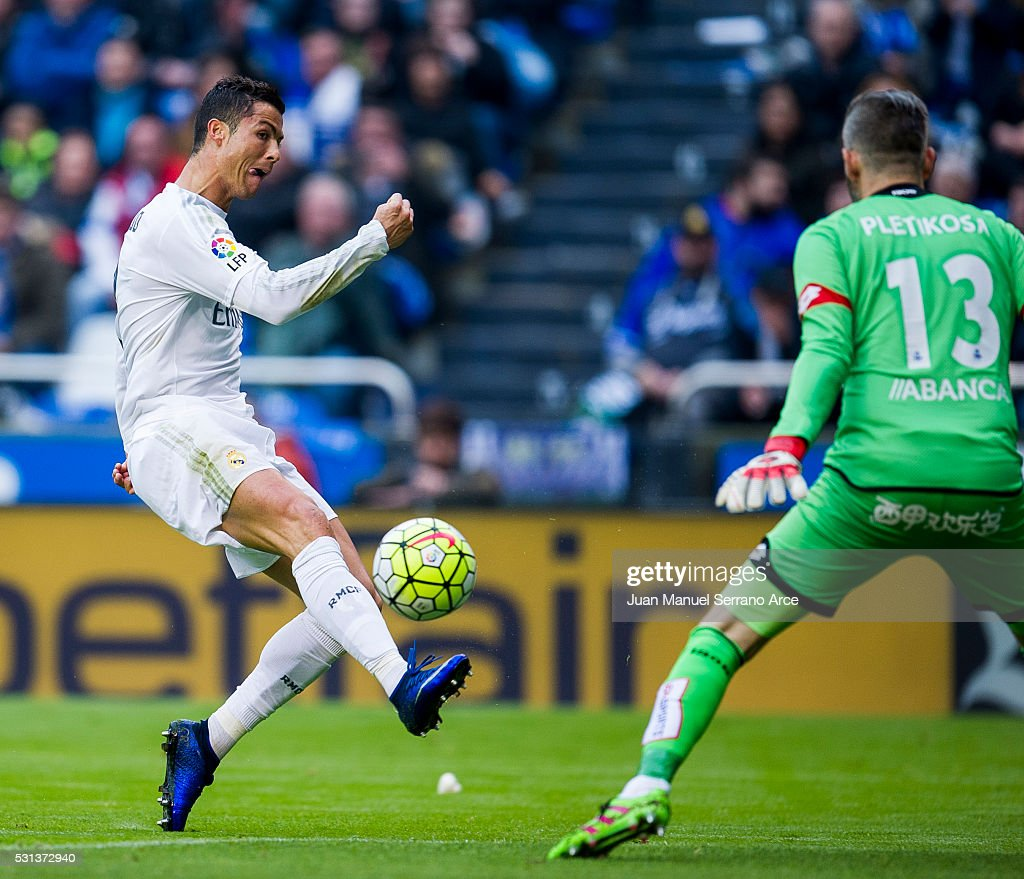 Cristiano Ronaldo of Real Madrid duels for the ball with Stipe Pletikosa of RC Deportivo La Coruna during the La Liga match between RC Deportivo La...