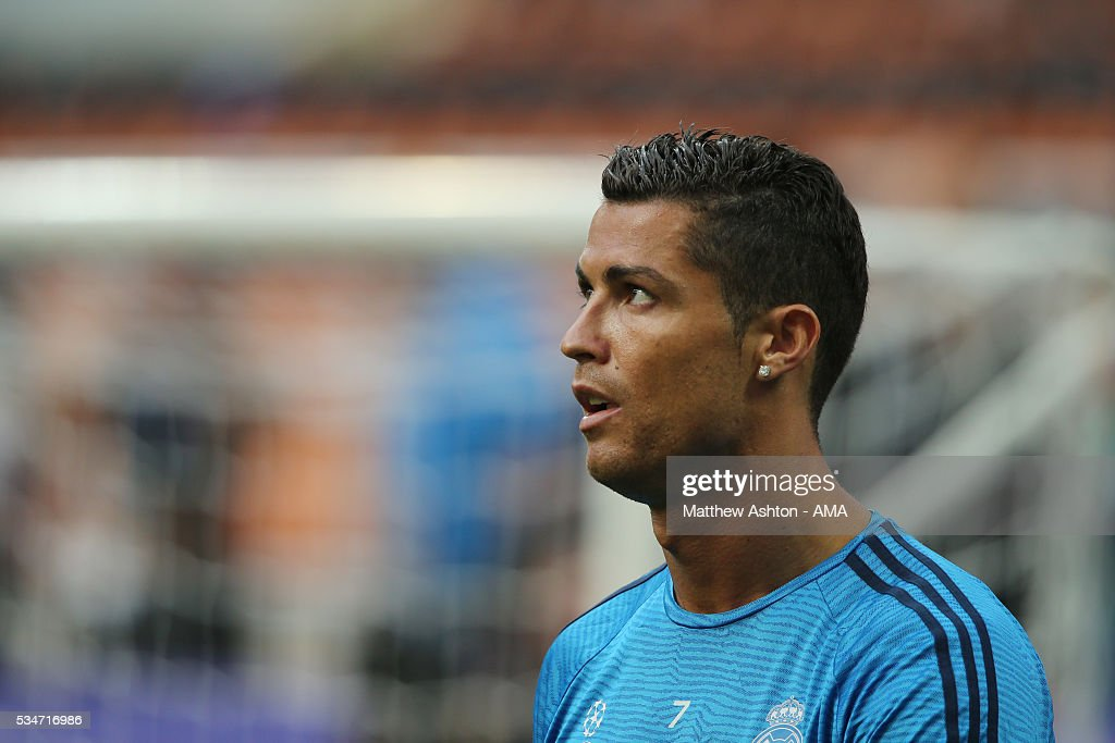 <a gi-track='captionPersonalityLinkClicked' href=/galleries/search?phrase=Cristiano+Ronaldo+-+Soccer+Player&family=editorial&specificpeople=162689 ng-click='$event.stopPropagation()'>Cristiano Ronaldo</a> of Real Madrid during the Real Madrid training session ahead of the UEFA Champions League Final at Stadio Giuseppe Meazza on May 27, 2016 in Milan, Italy.