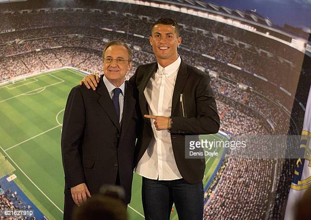 Cristiano Ronaldo of Real Madrid embraces club President Florentino Perez during a press conference after signing a new fiveyear contract with the...