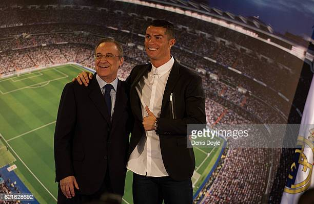Cristiano Ronaldo of Real Madrid embraces club President Florentino Perez following his press conference after signing a new fiveyear contract with...