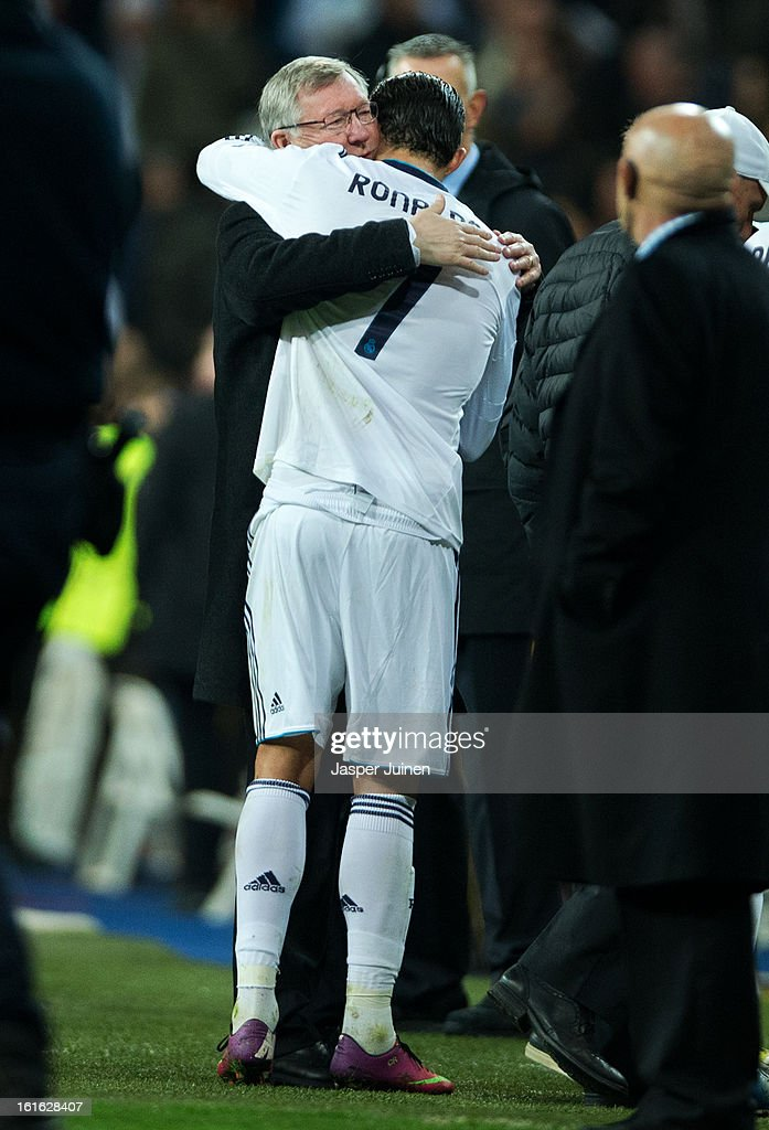 <a gi-track='captionPersonalityLinkClicked' href=/galleries/search?phrase=Cristiano+Ronaldo&family=editorial&specificpeople=162689 ng-click='$event.stopPropagation()'>Cristiano Ronaldo</a> (R) of Real Madrid embraces Sir <a gi-track='captionPersonalityLinkClicked' href=/galleries/search?phrase=Alex+Ferguson&family=editorial&specificpeople=203067 ng-click='$event.stopPropagation()'>Alex Ferguson</a>, manager of Manchester United, at the end of the UEFA Champions League Round of 16 first leg match between Real Madrid and Manchester United at Estadio Santiago Bernabeu on February 13, 2013 in Madrid, Spain.