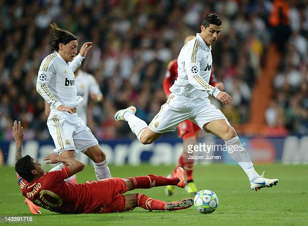 Cristiano Ronaldo of Real Madrid evades the tackle of Luiz Gustavo of Bayern Munich during the UEFA Champions League Semi Final second leg between...