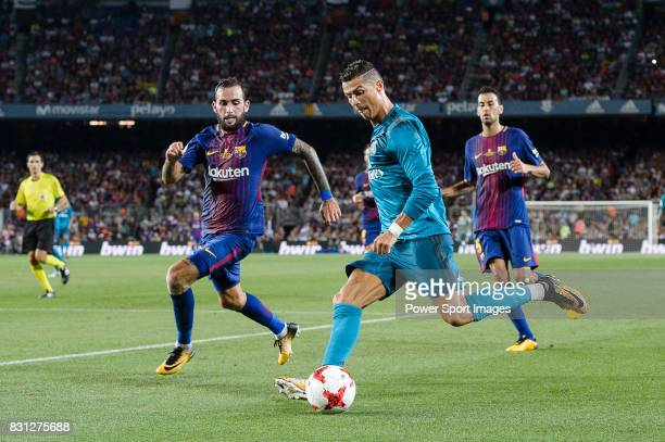 Cristiano Ronaldo of Real Madrid fights for the ball with Aleix Vidal of FC Barcelona during the Supercopa de Espana Final 1st Leg match between FC...