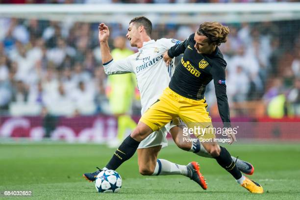 Cristiano Ronaldo of Real Madrid fights for the ball with Antoine Griezmann of Atletico de Madrid during their 201617 UEFA Champions League...