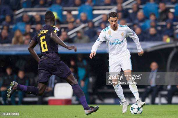 Cristiano Ronaldo of Real Madrid fights for the ball with Davinson Sanchez of Tottenham Hotspur FC during the UEFA Champions League 201718 match...