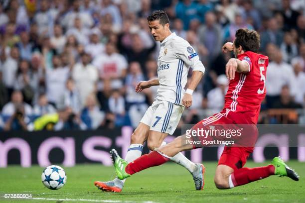 Cristiano Ronaldo of Real Madrid fights for the ball with Mats Hummels of FC Bayern Munich during their 201617 UEFA Champions League Quarterfinals...
