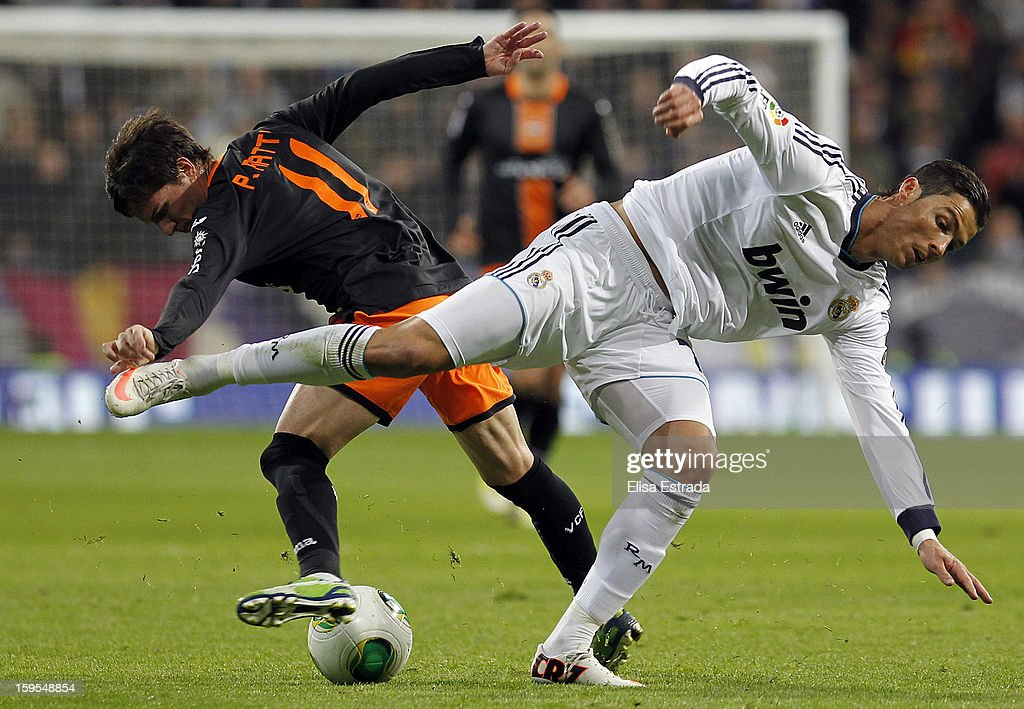 <a gi-track='captionPersonalityLinkClicked' href=/galleries/search?phrase=Cristiano+Ronaldo+-+Soccer+Player&family=editorial&specificpeople=162689 ng-click='$event.stopPropagation()'>Cristiano Ronaldo</a> of Real Madrid fights for the ball with <a gi-track='captionPersonalityLinkClicked' href=/galleries/search?phrase=Pablo+Piatti&family=editorial&specificpeople=4406769 ng-click='$event.stopPropagation()'>Pablo Piatti</a> of Valencia during the Copa del Rey Quarter Final match between Real Madrid and Valencia at Estadio Santiago Bernabeu on January 15, 2013 in Madrid, Spain.