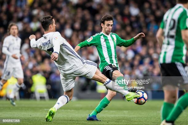 Cristiano Ronaldo of Real Madrid fights for the ball with Ruben Pardo Gutierrez of Real Betis during their La Liga match between Real Madrid and Real...