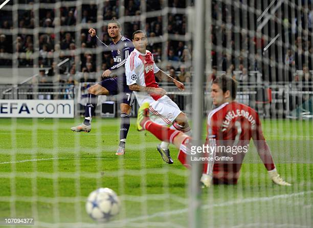 Cristiano Ronaldo of Real Madrid fires home the third goal past Maarten Stekelenburg of Ajax during the UEFA Champions League Group G match between...