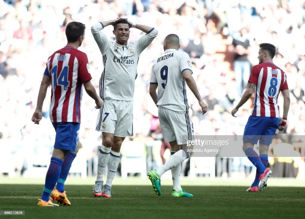 Who is favored in the Real Madrid vs. Atletico Madrid match?