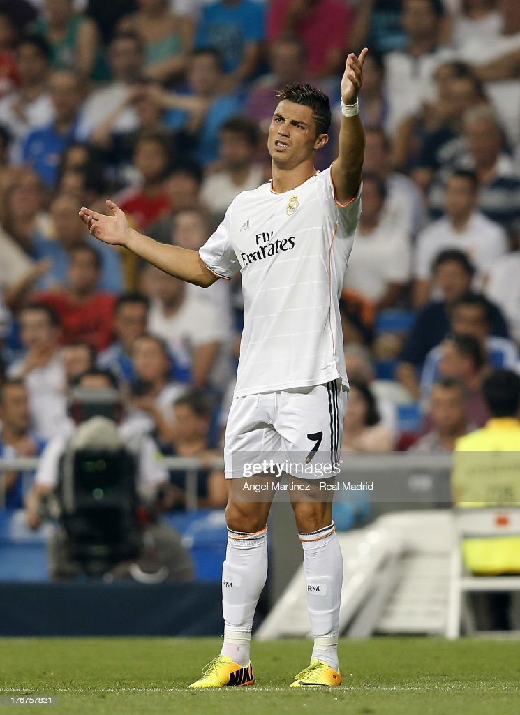 <a gi-track='captionPersonalityLinkClicked' href=/galleries/search?phrase=Cristiano+Ronaldo+-+Soccer+Player&family=editorial&specificpeople=162689 ng-click='$event.stopPropagation()'>Cristiano Ronaldo</a> of Real Madrid gestures during the La Liga match between Real Madrid CF and Real Betis at Estadio Santiago Bernabeu on August 18, 2013 in Madrid, Spain.
