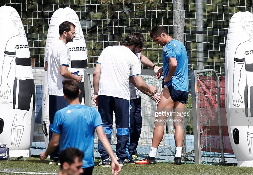 Cristiano Ronaldo (R)of Real Madrid gets injured during training session ahead of UEFA Champions League final football match between Atletico Madrid and Real Madrid CF in Madrid, Spain on May 24, 2016.