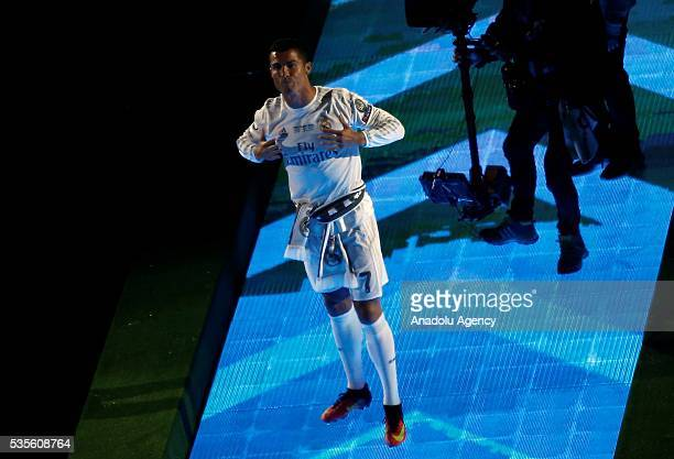 Cristiano Ronaldo of Real Madrid greets fans during the celebration after winning the UEFA Champions League Final match against Club Atletico de...