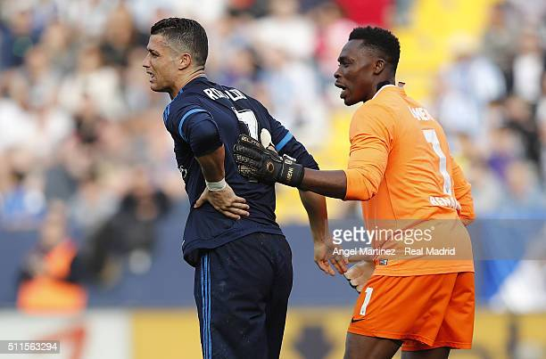 Cristiano Ronaldo of Real Madrid grimmaces in pain as Carlos Kameni of Malaga CF helps him during the La Liga match between Malaga CF and Real Madrid...