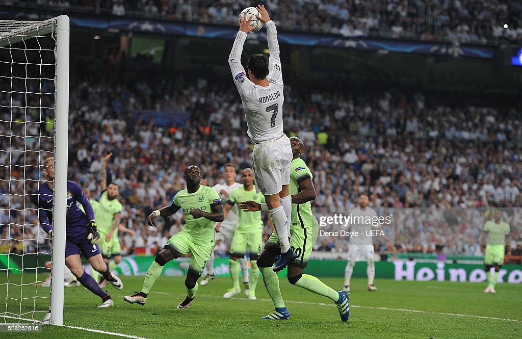Cristiano Ronaldo of Real Madrid handles the ball during the UEFA Champions League Semi Final second leg match between Real Madrid and Manchester City FC at Estadio Santiago Bernabeu on May 4, 2016 in Madrid, Spain.