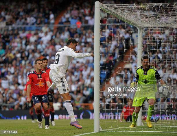 Cristiano Ronaldo of Real Madrid heads in his sides last minute winning goal during the La Liga match between Real Madrid and Osasuna at the Estadio...