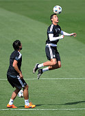 Cristiano Ronaldo of Real Madrid heads the ball beside Sami Khedira during the Real Madrid training at Valdebebas grounds ahead of the UEFA Champions...