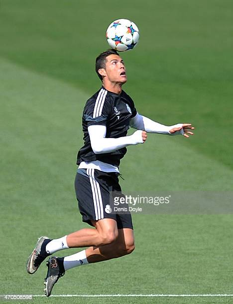 Cristiano Ronaldo of Real Madrid heads the ball during the Real Madrid training at Valdebebas grounds ahead of the UEFA Champions League Quarter...