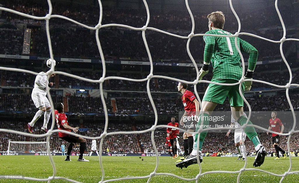 Cristiano Ronaldo of Real Madrid heads the ball to score past goalkeeper David de Gea of Manchester United during the UEFA Champions League Round of 16 first leg match between Real Madrid and Manchester United at Estadio Santiago Bernabeu on February 13, 2013 in Madrid, Spain.