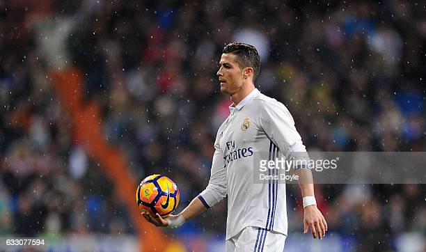 Cristiano Ronaldo of Real Madrid holds the matchball during the La Liga match between Real Madrid CF and Real Sociedad de Futbol at the Bernabeu on...