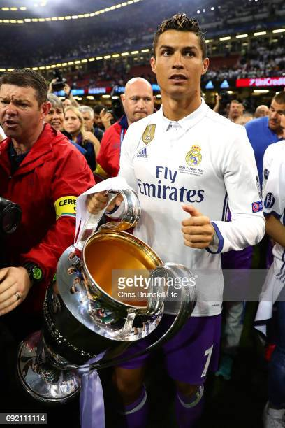 Cristiano Ronaldo of Real Madrid holds the trophy following the UEFA Champions League Final match between Juventus and Real Madrid at the National...