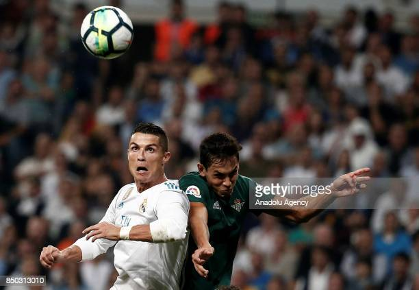 Cristiano Ronaldo of Real Madrid in action against Aissa Mandi of Real Betis during the Spanish La Liga match between Real Madrid and Real Betis at...