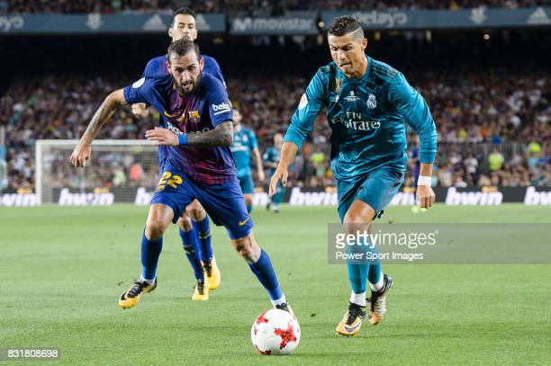 Cristiano Ronaldo of Real Madrid in action against Aleix Vidal of FC Barcelona during the Supercopa de Espana Final 1st Leg match between FC...