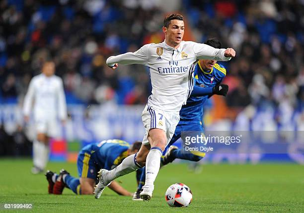 Cristiano Ronaldo of Real Madrid in action against Facundo Roncaglia of Celta de Vigo during the Copa del Rey Quarter Final First Leg match between...