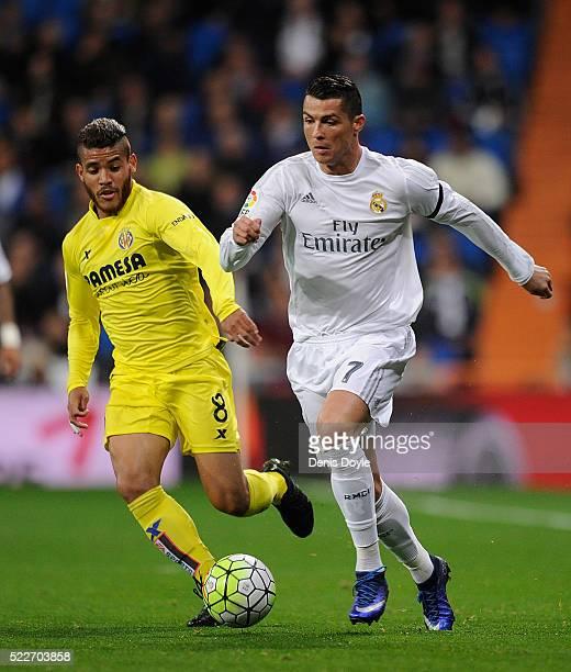 Cristiano Ronaldo of Real Madrid in action against Jonathan Dos Santos of Villarreal during the La Liga match between Real Madrid and Villarreal at...