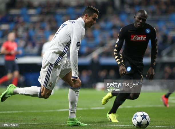 Cristiano Ronaldo of Real Madrid in action against Kalidou Koulibaly of Napoli during the UEFA Champions League round of 16 match between Real Madrid...
