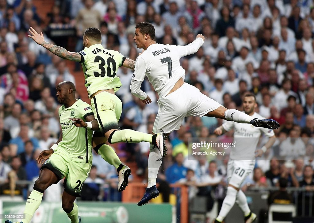 Cristiano Ronaldo (R) of Real Madrid in action against Nicolas Otamendi of Manchester City during the UEFA Champions League semi-final second leg football match between Real Madrid and Manchester City at the Santiago Bernabeu Stadium in Madrid, Spain on May 4, 2016.